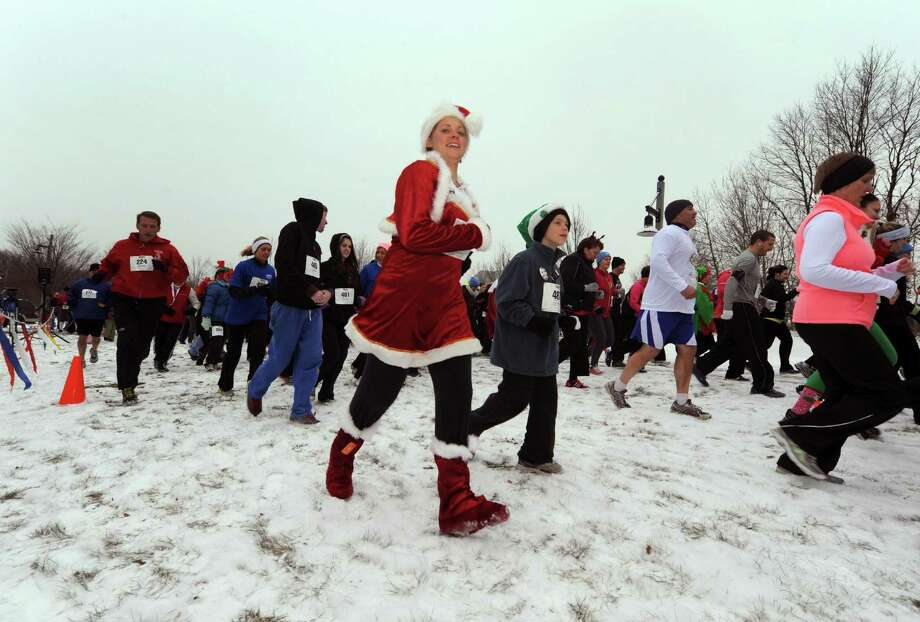 Runners take part in the 2012 Jingle Bell Run/Walk to benefit the Arthritis Foundation of Northeastern New York at the Crossings in a Colonie, NY Thursday Dec. 1, 2012. (Michael P. Farrell/Times Union) Photo: Michael P. Farrell