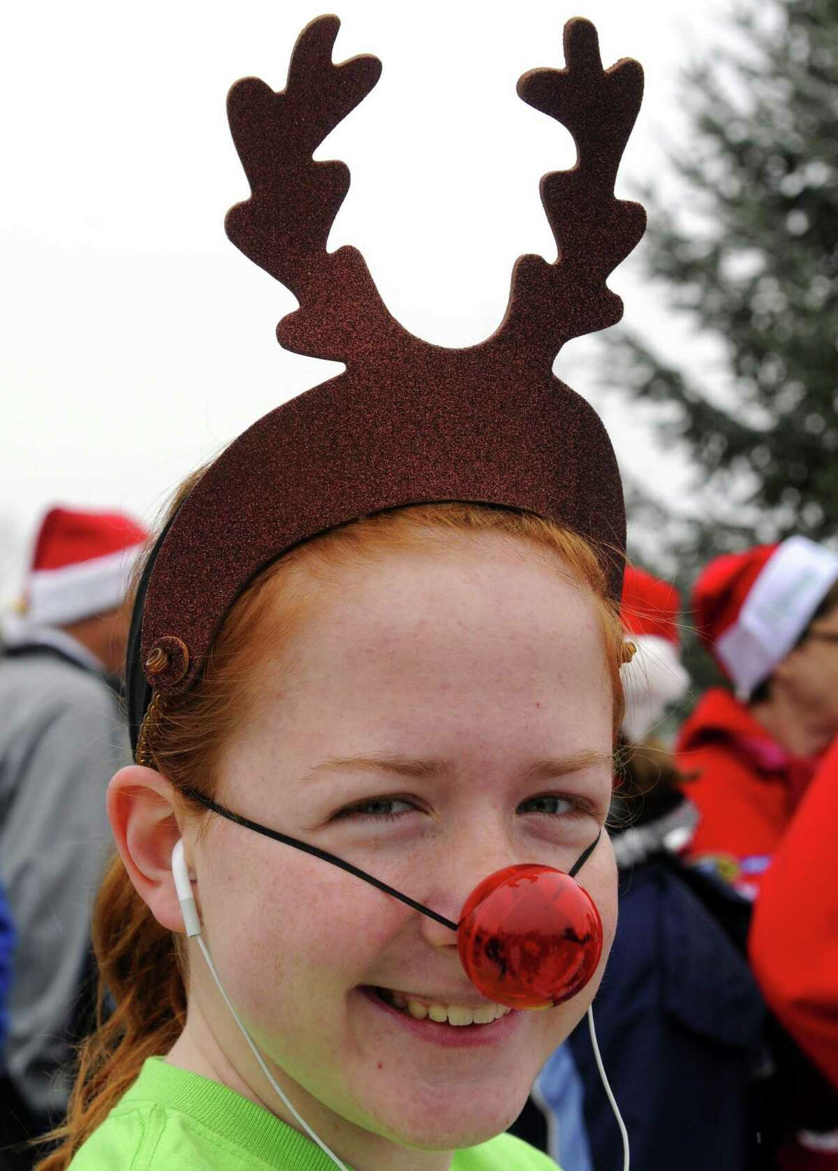 Fifteen-year-old Amanda Guzy of Latham takes part in the 2012 Jingle Bell Run/Walk to benefit the Arthritis Foundation of Northeastern New York at the Crossings in a Colonie, NY Thursday Dec. 1, 2012. (Michael P. Farrell/Times Union)