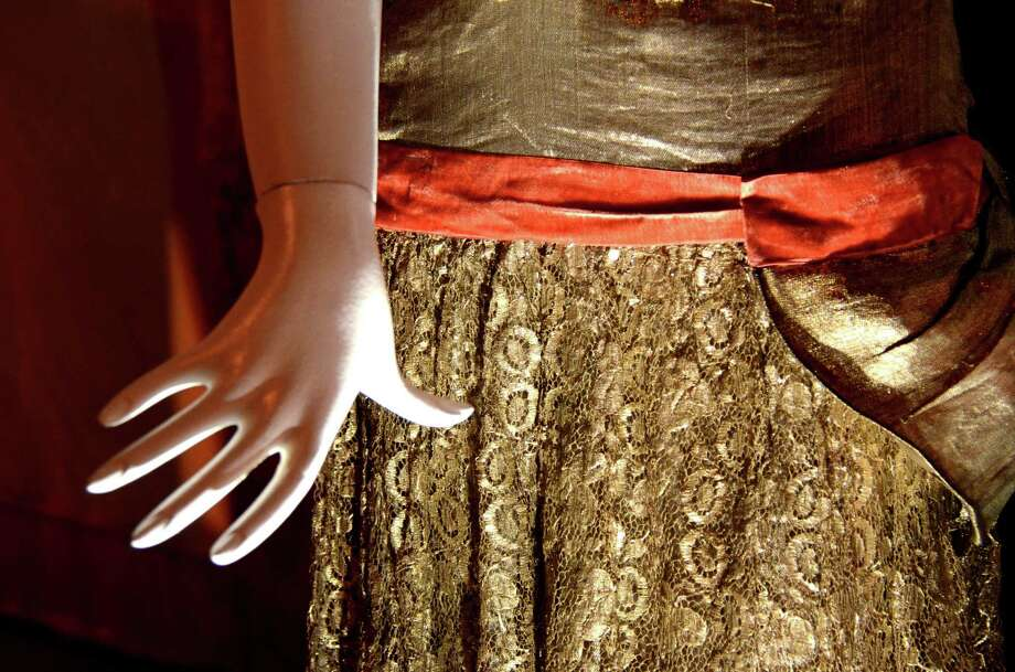 "A gold lame overblouse and skirt on display at the Darien Historical Society ""speakeasy"" on Thursday evening, Nov. 29, 2012 in Darien, Conn. Photo: Jeanna Petersen Shepard"
