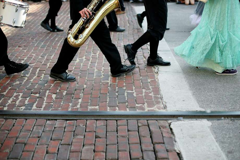 Members of the Bay Area Christian Bronco band, march down the parade route in costume Saturday, December 1, 2012 during the annual Dickens on The Strand celebration in Galveston. Photo: TODD SPOTH, For The Chronicle / Todd Spoth