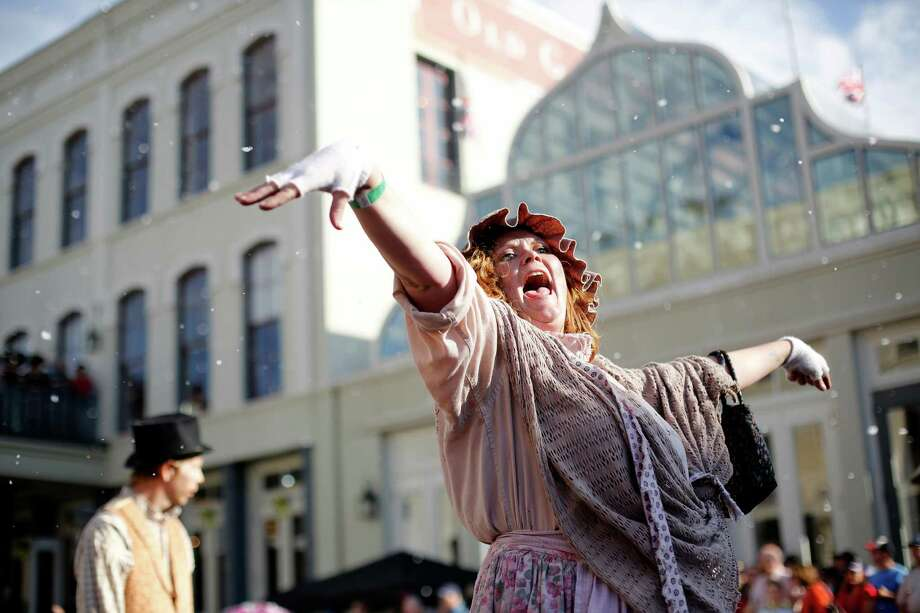 A woman dressed as a Victorian era beggar walks the parade route, Saturday, December 1, 2012 during the annual Dickens on The Strand celebration in Galveston, Texas. Photo: TODD SPOTH, For The Chronicle / Todd Spoth