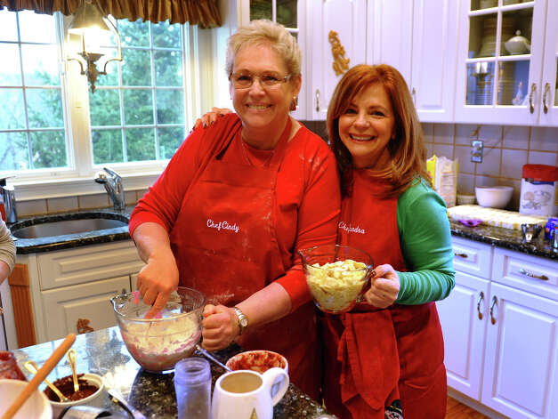 "Sandra Lee, right, and Cindy Slipko - ""The Cookie Ladies,"" two friends who have been baking together every December 1st, spent their 30th year together at Sandra's house to continue the tradition in Easton, Conn. on Saturday December 1, 2012. Together with friends, they bake over 7,000 cookies to give out to anyone who needs a special gift during the holidays, such as to the troops, local hospitals and orphanages to name a few. Photo: Christian Abraham / Connecticut Post"