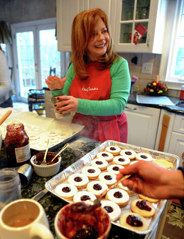 "Sandra Lee makes cookies at her home in Easton, Conn. on Saturday December 1, 2012. Sandra and her longtime freind Cindy Slipko, known as ""The Cookie Ladies,"" have been baking together every December 1st for 30 years. Together with friends, they bake over 7,000 cookies to give out to anyone who needs a special gift during the holidays, such as to the troops, local hospitals and orphanages to name a few. Photo: Christian Abraham / Connecticut Post"