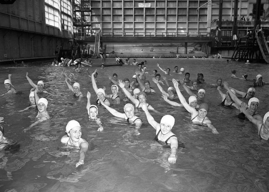 February 1947: A learn to swim class in one of the pools -- note the early water slides in the background. Sutro was the world's largest indoor swimming pool.  (Chronicle file)