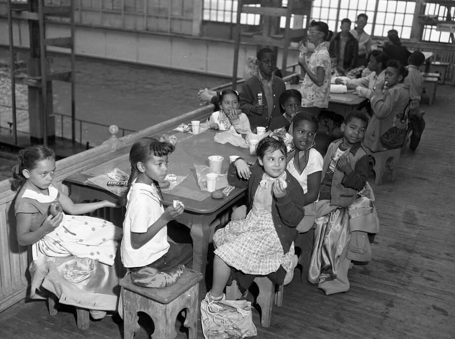 Feb. 24, 1953: Children eat lunch during the Sutro Baths Fun for a Day program. Kids traveled from throughout the city and enjoyed the facilities for free. (Chronicle file)