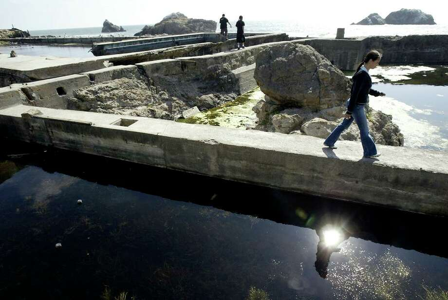 Aug. 16, 2006: The ruins of Sutro Baths are still visible at Lands End. Tourists from New York check them out here, completely unaware of the ghosts. (Darryl Bush / The Chronicle) Photo: Darryl Bush, SFC / The Chronicle