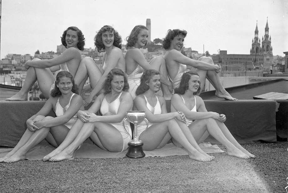 Sept. 8, 1947: Crystal Plunge swimmers celebrate victory. That's Ann Curtis next to the Coit Tower. Their coach, Charlie Sava, was a local legend.  (Aaron Rubino / The Chronicle)