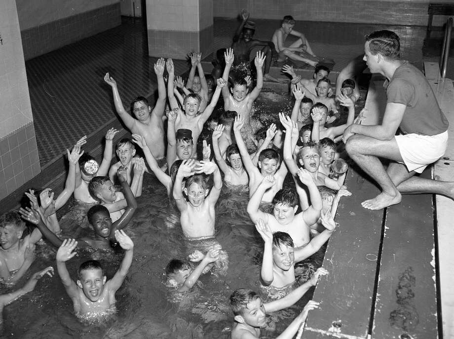 March 26, 1955: Children learn to swim from John Stonum in a glorified bathtub at the YMCA. The YMCA and YWCA were popular with youngsters. (Bob Campbell / The Chronicle)
