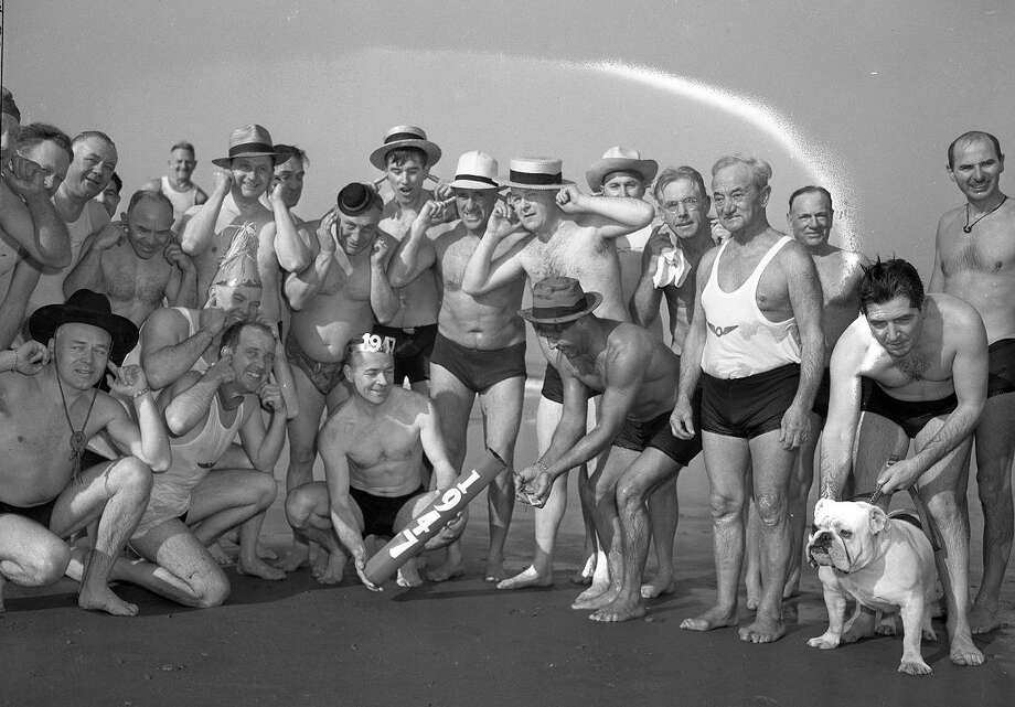 Jan. 1, 1947: Freezing swimmers from the Olympic Club, with a bulldog and some kind of heavy explosive, after their 1947 New Year's Day swim.  (Chronicle file)