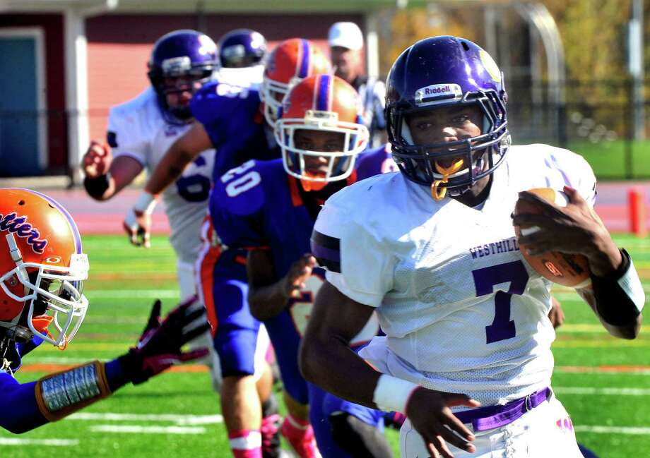 Davell Cotterell carries the ball as Danbury High School plays Westhill High School at Danbury Saturday, Oct. 20, 2012. Photo: Michael Duffy / The News-Times
