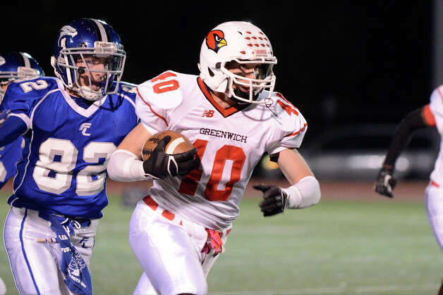 Greenwich #40 Taylor Olmstead gains yardage as Fairfield Ludlowe High School hosts Greenwich High School in varsity football in Fairfield, CT on Oct. 12, 2012. Photo: Shelley Cryan / Shelley Cryan for the CT Post/ freelance Shelley Cryan