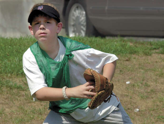 Greenwich, Aug. 19, 2002.  Taylor Olmstead, 7, at the softball/baseball/basket ball camp at the Western Greenwich Civic Center.  Photo/Helen Neafsey color. Photo: Helen Neafsey
