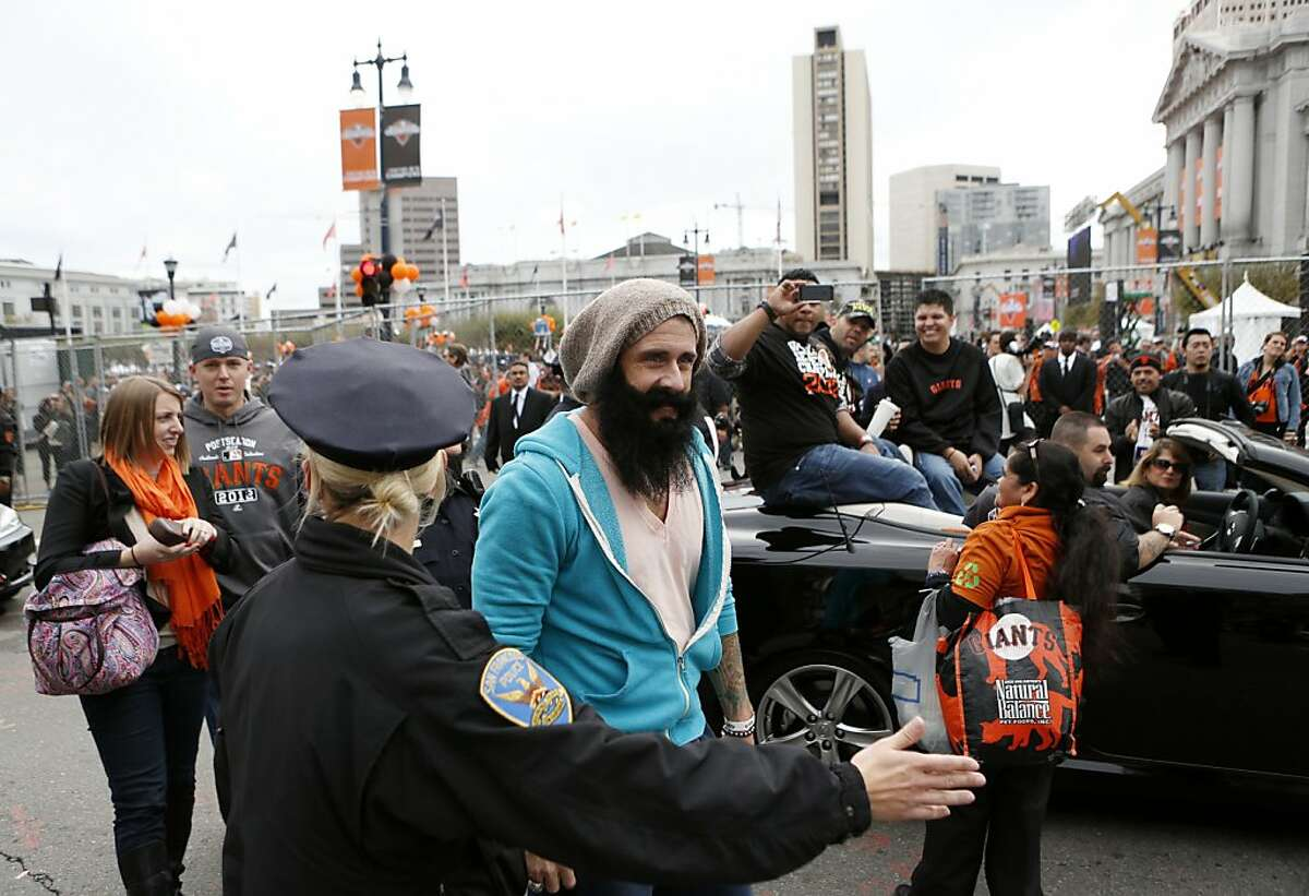 Giants pitcher Brian Wilson walks during the World Series victory parade on Wednesday, October 31, 2012 in San Francisco, Calif.