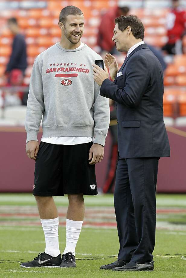 Steve Young (right) says the tough times have only just begun for Alex Smith. Photo: Tony Avelar, Associated Press