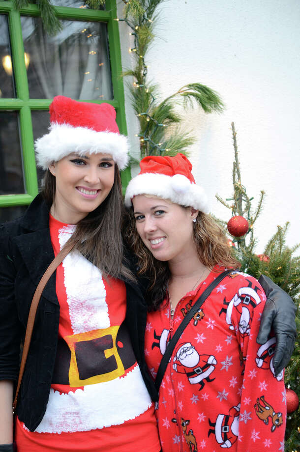Casey Docherty, of Stamford, and her roommate Kasey Satterley, also of Stamford, pose for a photo in front of Tigin on Bedford Street in Stamford during the annual Stamford SantaCon pub crawl on Saturday, Dec. 1, 2012. Photo: Amy Mortensen / Connecticut Post Freelance