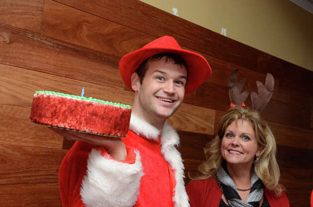 Chris Gradel, of Stamford, and Sheri Tackett, of Ohio, wait to surprise birthday boy, Stu Tackett, at Butterfield8 on Bedford Street in Stamford during the annual Stamford SantaCon pub crawl on Saturday, Dec. 1, 2012. Photo: Amy Mortensen / Connecticut Post Freelance