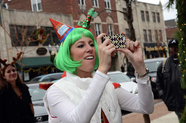 Michele Tackett, of Stamford, takes a photo at Butterfield8 on Bedford Street in Stamford during the annual Stamford SantaCon pub crawl on Saturday, Dec. 1, 2012. Photo: Amy Mortensen / Connecticut Post Freelance