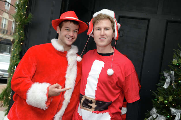 Chris Gradel, of Stamford, poses for a photo with Mike Zarolinski, also of Stamford, at Butterfield8 on Bedford Street in Stamford during the annual Stamford SantaCon pub crawl on Saturday, Dec. 1, 2012. Photo: Amy Mortensen / Connecticut Post Freelance