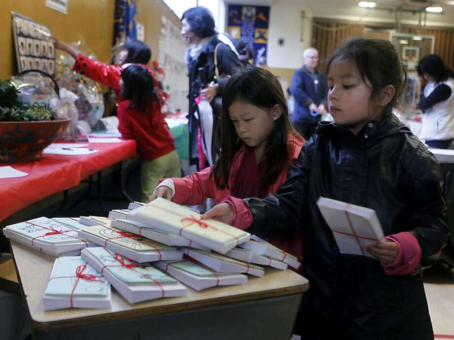 First-graders Amanda Dong (left) and Rowan Dawson are among 22 students in Josephine Lucchesi's class who created a series of cards to sell Saturday at West Portal Lutheran School's annual Christmas Fair. The class is donating the proceeds to the Season of Sharing Fund. Photo: Paul Chinn, The Chronicle