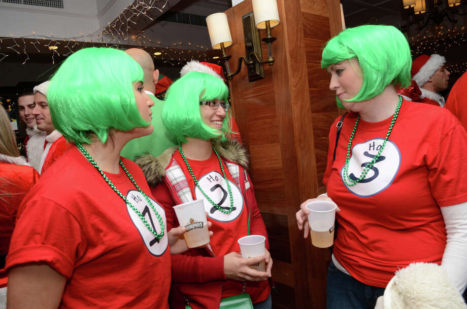Stamford residents Christin Mone, Irene Serrano and Kristen Frechette, dressed as Ho 1, Ho 2, and Ho 3, enjoy a drink at Butterfield8 on Bedford Street in Stamford during the annual Stamford SantaCon pub crawl on Saturday, Dec. 1, 2012. Photo: Amy Mortensen / Connecticut Post Freelance