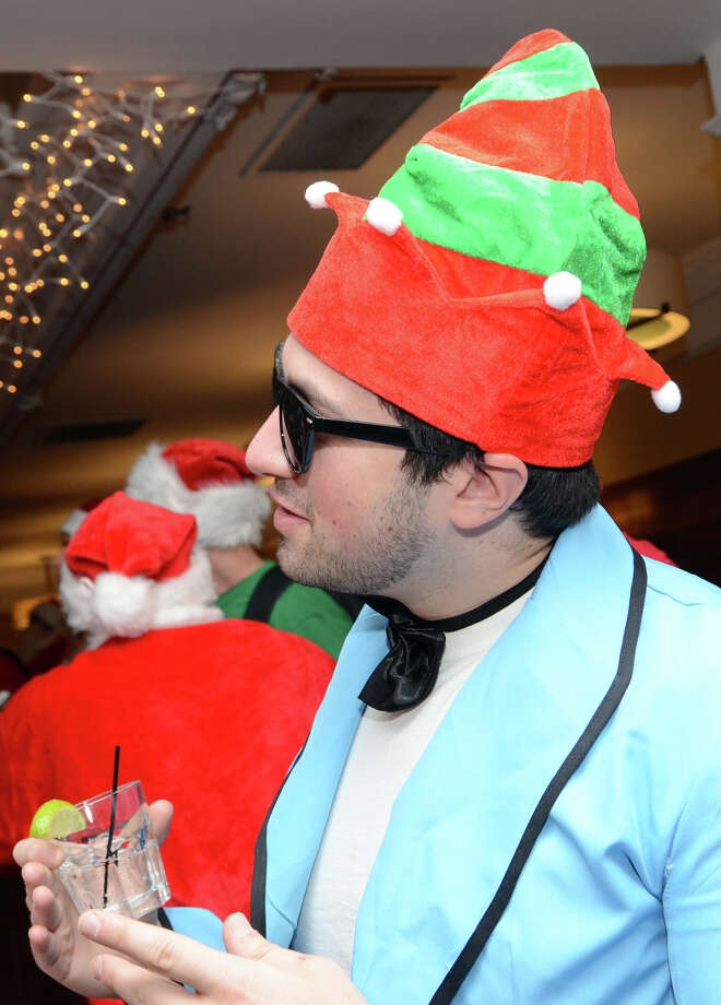John Cornell, of Stamford, enjoys a beverage at Butterfield8 on Bedford Street in Stamford during the annual Stamford SantaCon pub crawl on Saturday, Dec. 1, 2012. Photo: Amy Mortensen / Connecticut Post Freelance