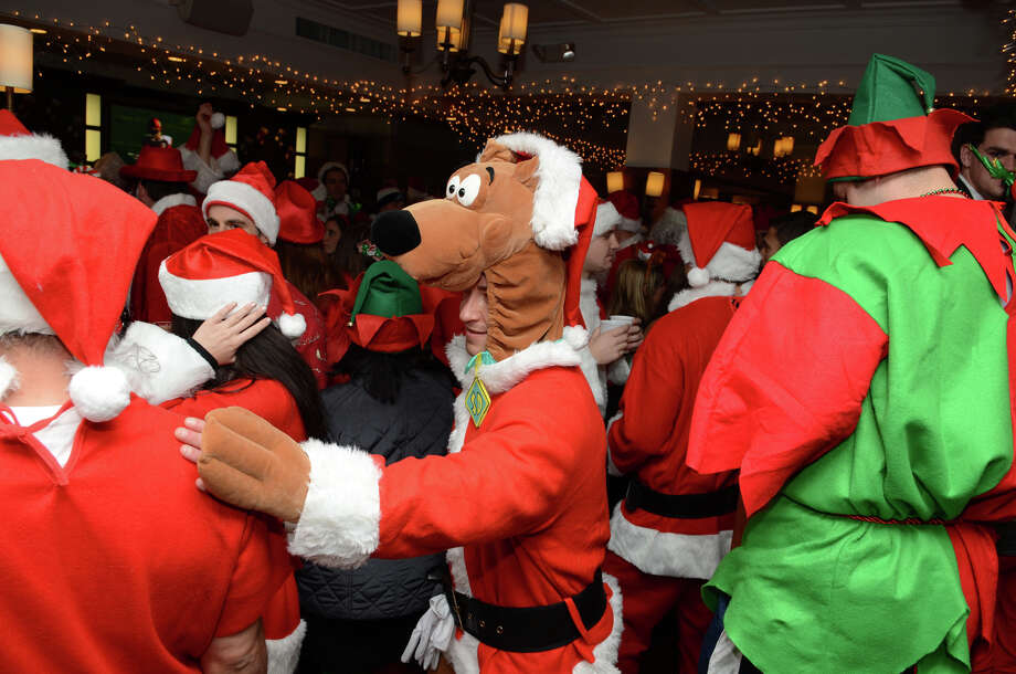 Scooby Doo makes an appearance at Butterfield8 on Bedford Street in Stamford during the annual Stamford SantaCon pub crawl on Saturday, Dec. 1, 2012. Photo: Amy Mortensen / Connecticut Post Freelance