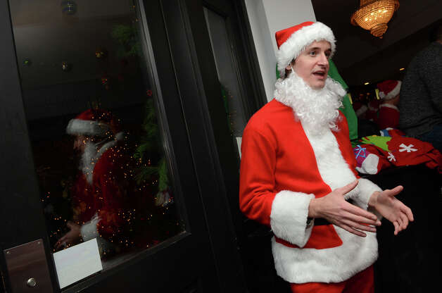 Scott Richards, of Stamford, talks about SantaCon while at Butterfield8 on Bedford Street in Stamford during the annual Stamford SantaCon pub crawl on Saturday, Dec. 1, 2012. Photo: Amy Mortensen / Connecticut Post Freelance