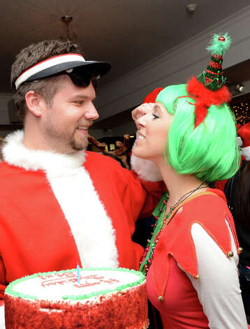 Stu Tackett, of Stamford, celebrates his birthday with his wife, Michelle, at Butterfield8 on Bedford Street in Stamford during the annual Stamford SantaCon pub crawl on Saturday, Dec. 1, 2012. Photo: Amy Mortensen / Connecticut Post Freelance