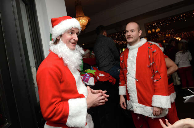 Scott Richards, of Stamford, and John Harlper, also of Stamford, talk about SantaCon while at Butterfield8 on Bedford Street in Stamford during the annual Stamford SantaCon pub crawl on Saturday, Dec. 1, 2012. Photo: Amy Mortensen / Connecticut Post Freelance