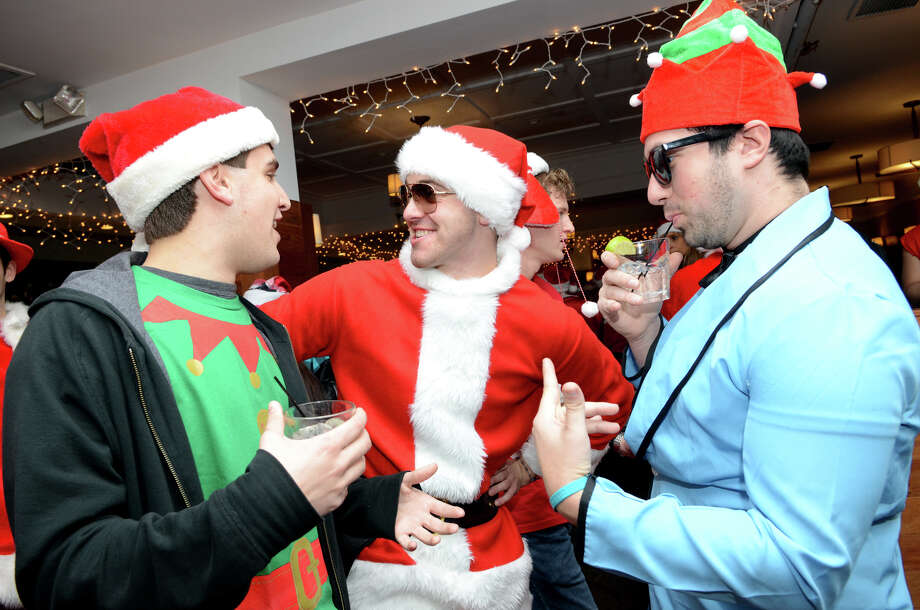 Kyle Nemchek, of Stamford, Max Powers, of Stamford, and John Cornell, of Stamford, enjoy pleasant conversation at Butterfield8 on Bedford Street in Stamford during the annual Stamford SantaCon pub crawl on Saturday, Dec. 1, 2012. Photo: Amy Mortensen / Connecticut Post Freelance