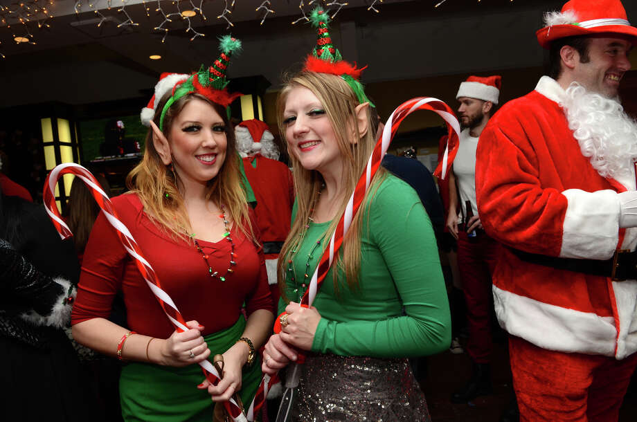 Corrine Seldon and Jessica Alabama, both of Carmel, NY, pose for a photo at Butterfield8 on Bedford Street in Stamford during the annual Stamford SantaCon pub crawl on Saturday, Dec. 1, 2012. Photo: Amy Mortensen / Connecticut Post Freelance