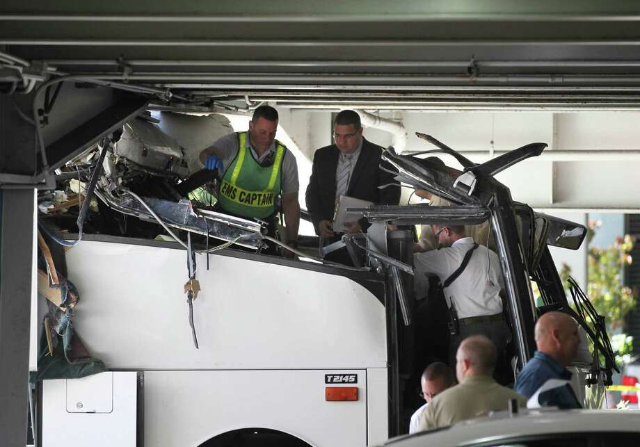 A bus crashed into an overpass in Miami, Florida, on Saturday, December 1, 2012, killing 2 people, and injuring 30 others-- some critically. Photo: Peter Andrew Bosch, McClatchy-Tribune News Service / Miami Herald