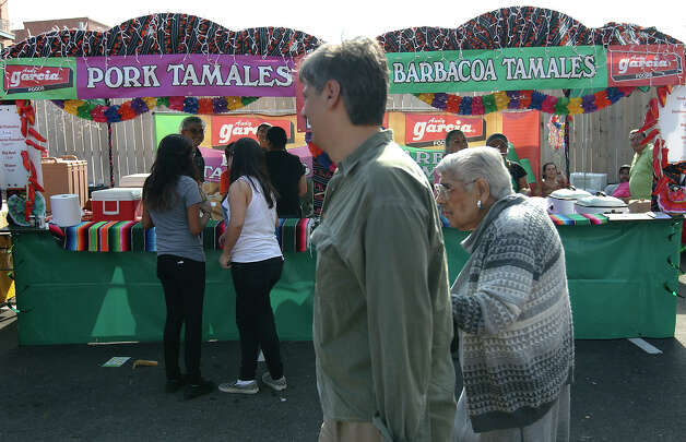 Thousands of hungry visitors line up for tamales at the Country of 1100 Tamales at Pearl event on Saturday, Dec. 1, 2012. Tamales from 40 tamal makers offered traditional and innovative styles to satisfy every appetite. Photo: Kin Man Hui, Express-News / © 2012 San Antonio Express-News