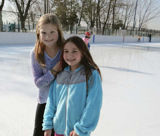Westporters Simone Lantier and Daniella Gat, both 10, enjoy the ice on the opening day of the Westport PAL ice rink at Longshore. Photo: Mike Lauterborn / Westport News contributed