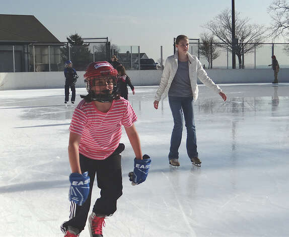 Madison Andrews, 10, of Darien, tears up the ice as she practices for a future ice hockey game at the Westport PAL rink at Longshore. Photo: Mike Lauterborn / Westport News contributed