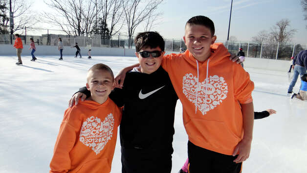 Colin Konstanty, 8; Zach Iannacone, 10, and A.J. Konstanty, 10, all of Westport, at the opening of the Westport PAL ice rink. Photo: Mike Lauterborn / Westport News contributed