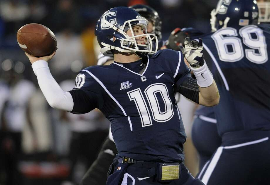 Chandler Whitmer throws a pass vs Cincinnati during last year's UConn football season. The Huskies were voted to finish seventh in the inaugural American Conference season. (AP Photo)