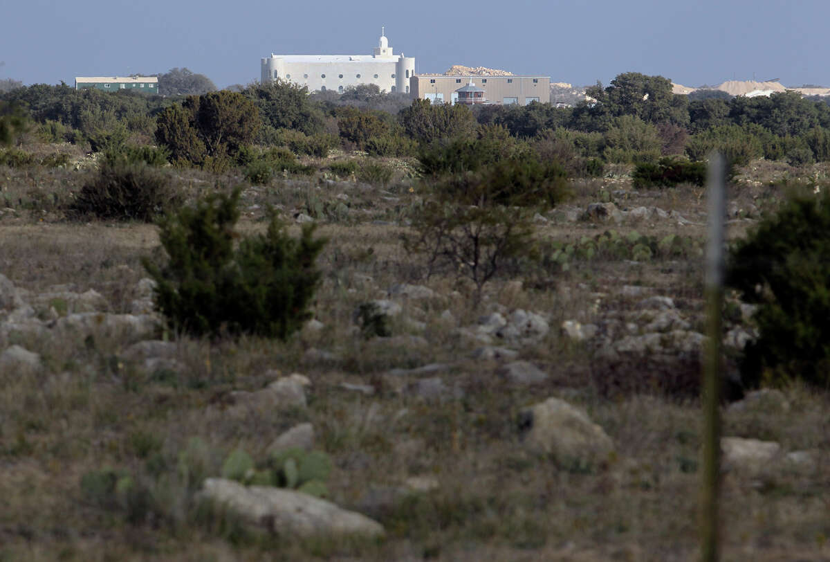 The temple at the Yearning for Zion ranch can be seen on the horizon through scattered brush land about five miles outside the town of Eldorado, Texas on Thursday, Nov. 29, 2012. The Texas attorney general's office had filed for seizure of the property on Wednesday.