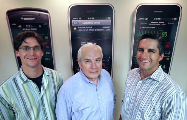 Trey Moore Chief Technology Officer, left, Gene Powell CEO, center, Dr. Cameron Powell President and Chief Medical Officer, of AirStrip Technologies, in their office, Tuesday, March 30, 2010. Photo: BOB OWEN, SAN ANTONIO EXPRESS-NEWS / rowen@express-news.net