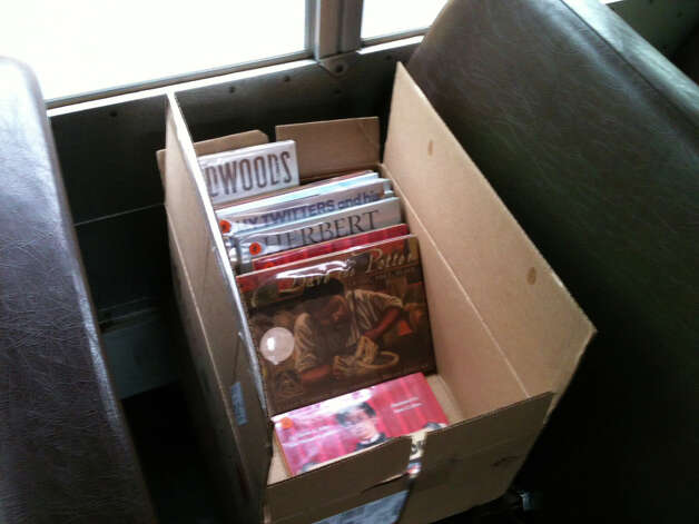 A box of books on the bookmobile that visited Osborn Hill School on Tuesday. The school's library has been closed since the discovery of PCBs.  Fairfield CT 11/27/12 Photo: Andrew Brophy / Fairfield Citizen contributed