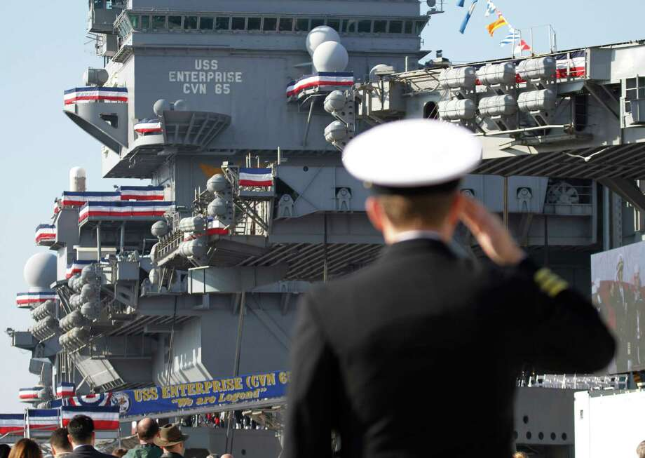 A Navy officer salutes during the inactivation ceremony for the first nuclear powered aircraft carrier USS Enterprise at Naval Station Norfolk  Saturday, Dec. 1, 2012 in Norfolk, Va.   The ship served in the fleet for 51 years. Photo: Steve Helber, Associated Press / AP