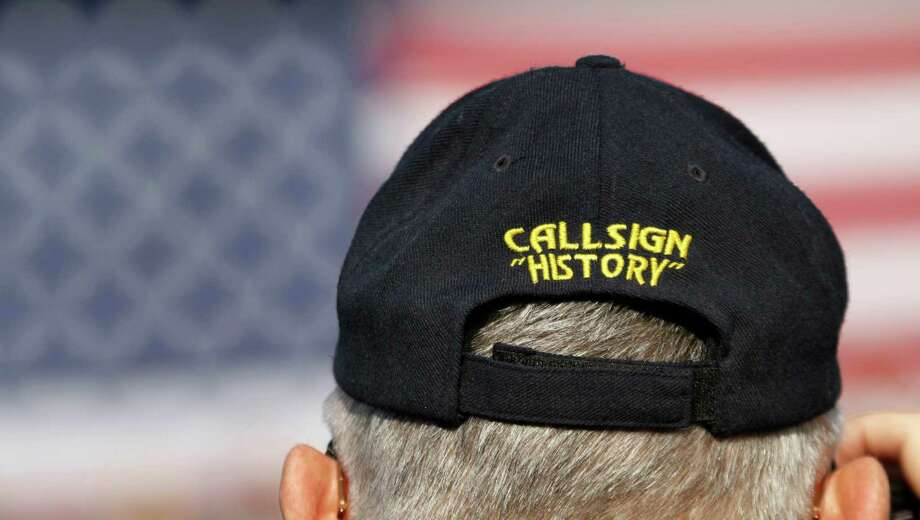 A retired crewman from the USS Enterprise wears an enterprise hat during the inactivation ceremony for the first nuclear powered aircraft carrier at Naval Station Norfolk  Saturday, Dec. 1, 2012 in Norfolk, Va.   The ship served in the fleet for 51 years. Photo: Steve Helber, Associated Press / AP