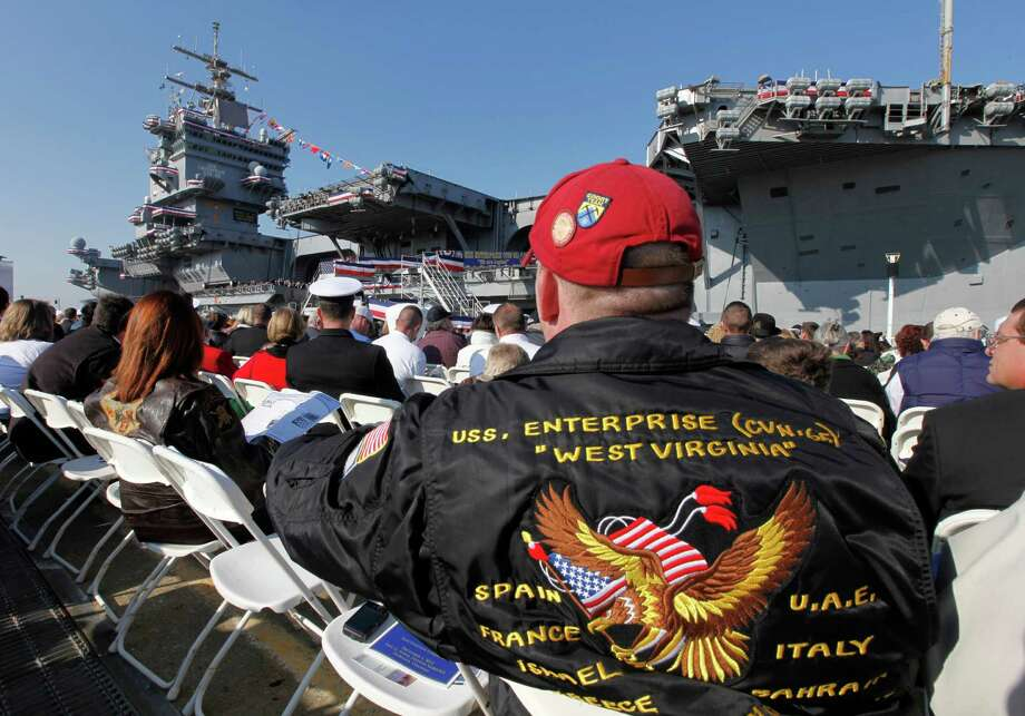 Ronnie Jarrett, of Danville Pa., wears his USS Enterprise cruise jacket during the inactivation ceremony for the first nuclear powered aircraft carrier USS Enterprise at Naval Station Norfolk  Saturday, Dec. 1, 2012 in Norfolk, VA.   The ship served in the fleet for 51 years. Photo: Steve Helber, Associated Press / AP