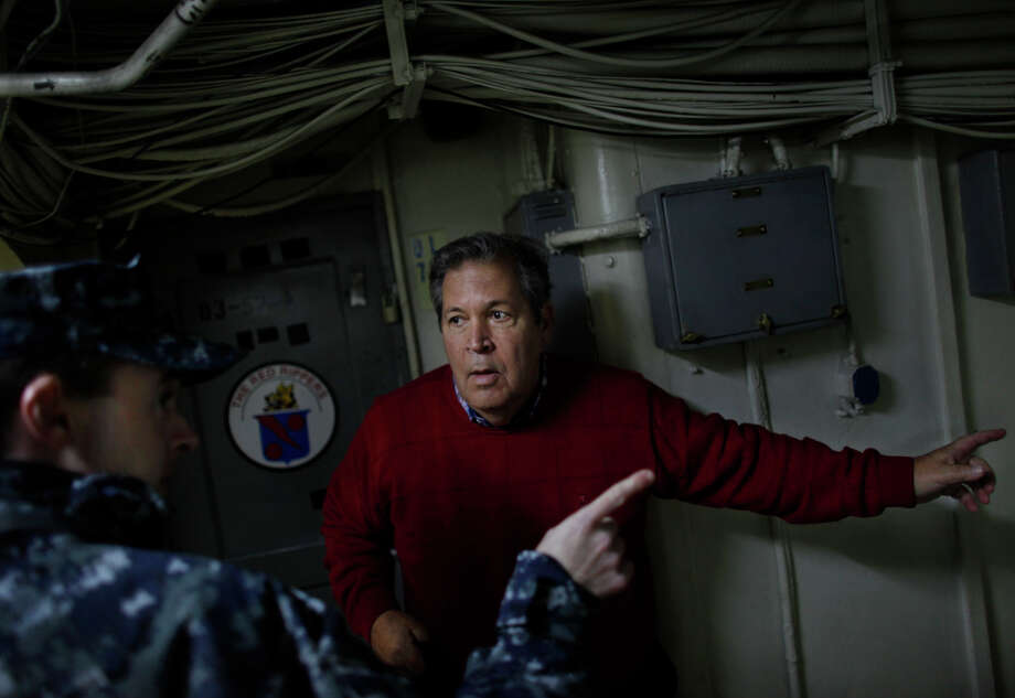 Bob Lewis tries to find his old quarters aboard the USS Enterprise during a tour of the ship Friday, Nov. 30, 2012, in Norfolk, Va. Lewis was an A-4 Skyhawk fighter pilot during the Vietnam War who flew 219 combat missions from The Big E. Photo: Stephen M. Katz, Associated Press / The Virginian-Pilot