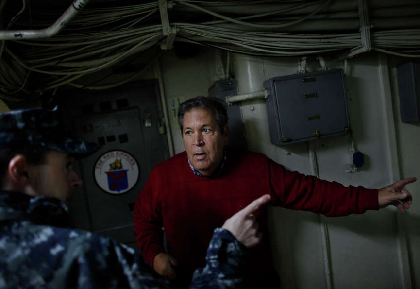 Bob Lewis tries to find his old quarters aboard the USS Enterprise during a tour of the ship Friday,