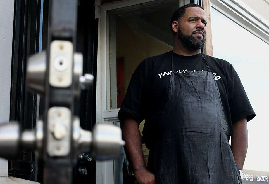 Robeson Perry says he is seeing more crime around his Famous One's Barber Shop on International Boulevard. Photo: Lacy Atkins, The Chronicle