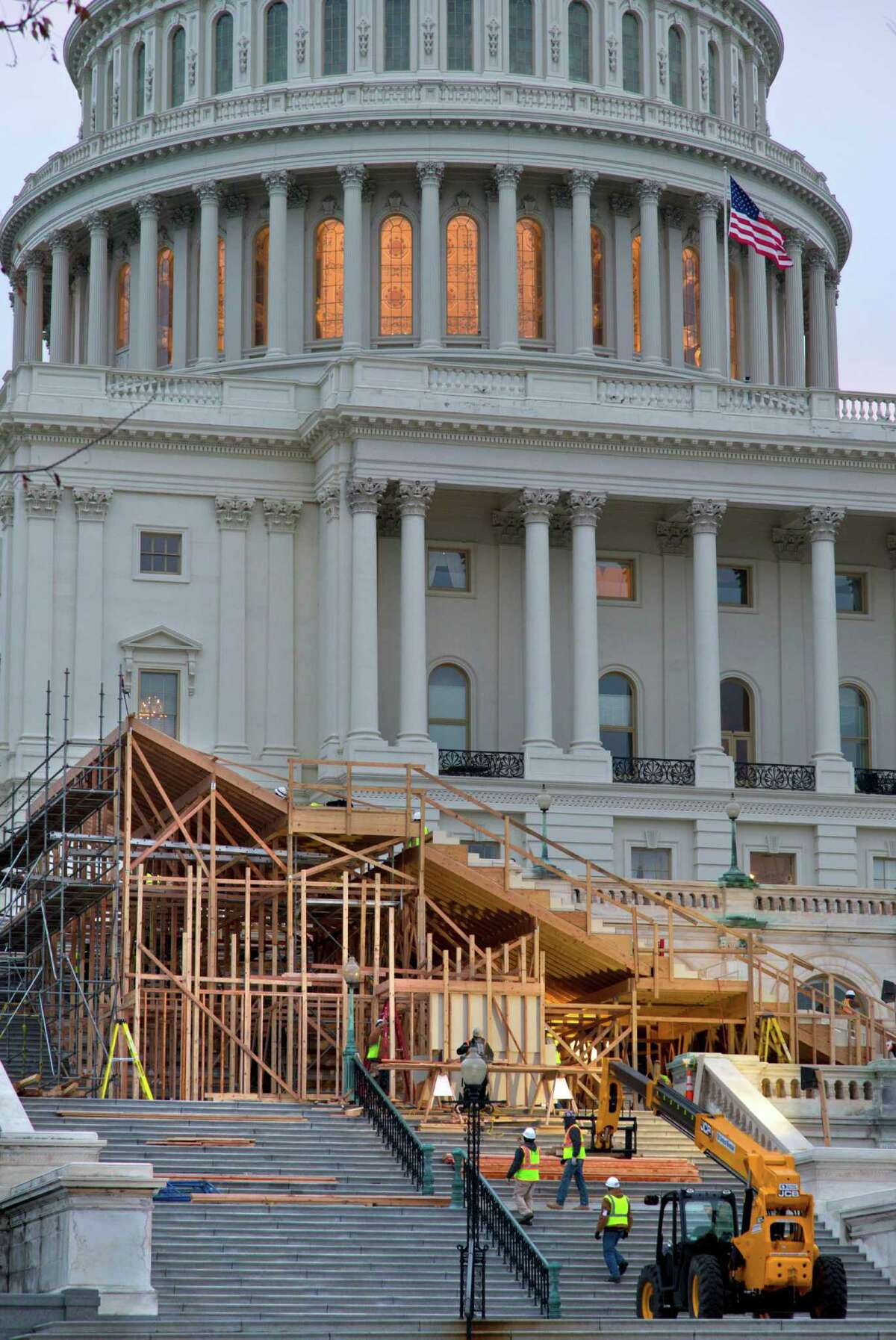 Construction continues on the viewing stands for President Barack Obama's January's Inauguration Day ceremonies, early Wednesday, Nov. 28, 2012, on Capitol Hill in Washington. (AP Photo/J. Scott Applewhite)