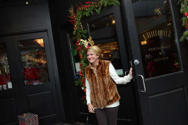 A patron walks out of Butterfield8 on Bedford Street in Stamford during the annual Stamford SantaCon pub crawl on Saturday, Dec. 1, 2012. Photo: Amy Mortensen / Connecticut Post Freelance