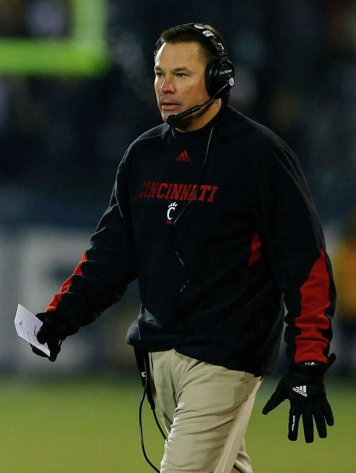 EAST HARTFORD, CT - DECEMBER 1: Head coach Butch Jones of the Cincinnati Bearcats watches his team play against the Connecticut Huskies during the game at Rentschler Field on December 1, 2012 in East Hartford, Connecticut. (Photo by Jared Wickerham/Getty Images) Photo: Jared Wickerham, Getty Images / 2012 Getty Images