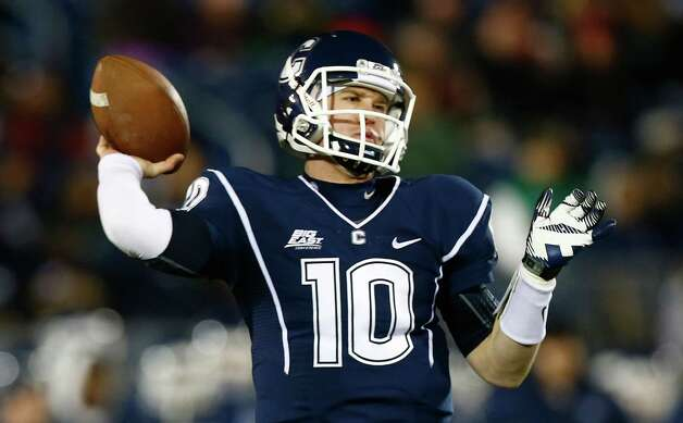 EAST HARTFORD, CT - DECEMBER 1: Chandler Whitmer #10 of the Connecticut Huskies throws a pass against the Cincinnati Bearcats during the game at Rentschler Field on December 1, 2012 in East Hartford, Connecticut. (Photo by Jared Wickerham/Getty Images) Photo: Jared Wickerham, Getty Images / 2012 Getty Images